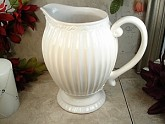 "Couture Line Embossed Cream Ceramic 8"" pitcher"